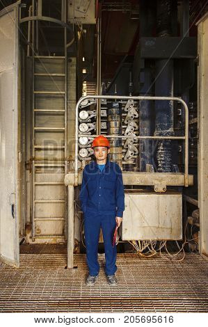 Padaeng industry Mae Sot Tak Thailand February20 2013 : Zinc mine. Portrait of engineer and his workplace.