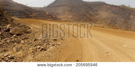 Road to zinc mine. Background of mining industrial landscape on the open pit. Opencast textured land.