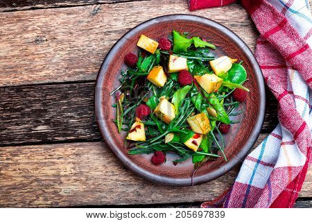 Warm Pumpkin Salad With Raspberries And Mixed Leaf Of Arugula, Chard, In Brown Plate On Wooden Rusti
