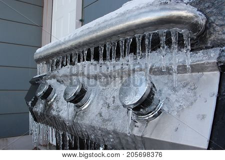 Barbecue Grill Covered in Ice in Winter