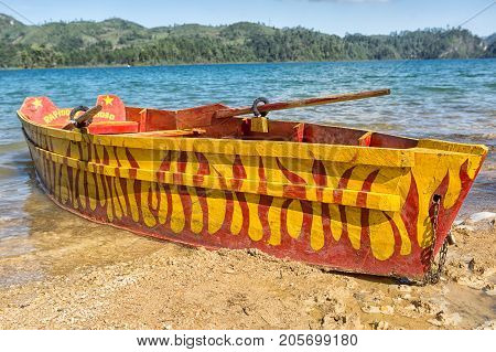 December 22 2014 Lagunas de Montebello National Park Mexico: colourful wood boat on the shore of the blue water of Cinco Lagos is popular with tourists