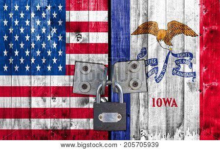 US and Iowa flag on door with padlock
