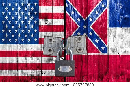 US and Mississippi flag on door with padlock