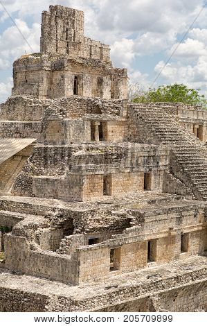 closeup details of the architectural style of the main structure of Edzna mayan temple