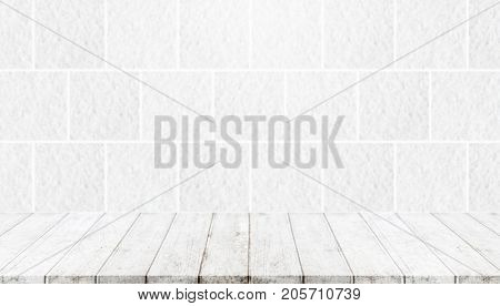 Wood table top and background of white stone wall - can used for display or montage your products.