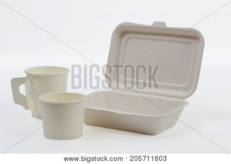 Set of unbleached plant fiber food box and paper coffee cup isolated on white with clipping path, Natural fiber eco food and drink packaging.