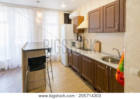 Kitchen Interior With A Bar Counter In The Apartment