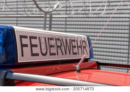 German red fire brigade car with blue light
