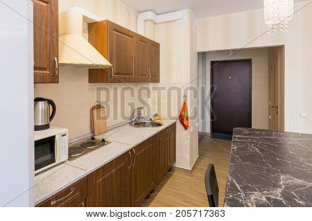 Interior Of Modern Kitchen And Entrance To The Apartment