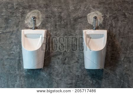 Urinal in male restroom in modern style