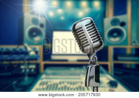 Retro microphone over the photo blurred of music studio band background with music instrument musical concept