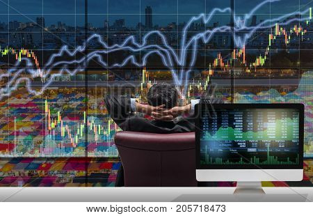 Back side of sitting businessman who is looking at stock market exchange graph over the cityscape with Computer show Trading graph background on the table Business technology and trading concept, 3D illustration