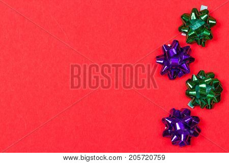 Bows for anniversary decoration on red background