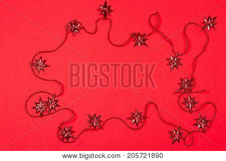 decorative festive garland on a red background