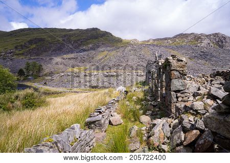 Ruins of a slate building in the countryside of Wales, United Kingdom. Industrial ruins: abandoned slate quarries in North Wales.