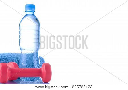 Fitnes symbols - blue dumbbells a bottle of water and a towel. The concept of a healthy lifestyle.