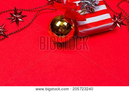 Christmas red background with gift and decoration on the red background