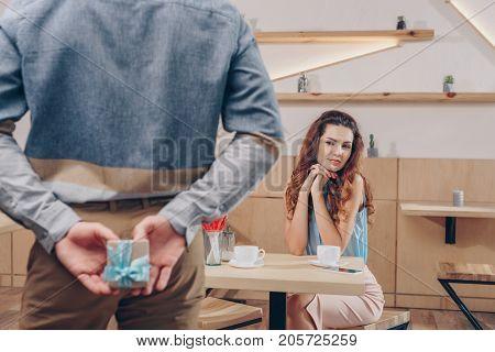 Man Holding Gift For Girlfriend