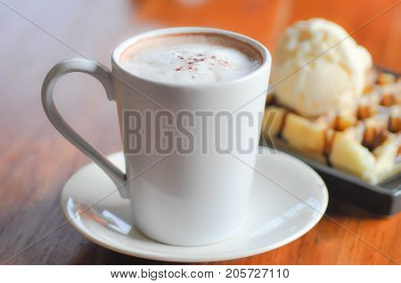hot coffee or hot cappuccino and dessert