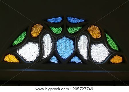 Window of colored glass of a house at Sana on Yemen