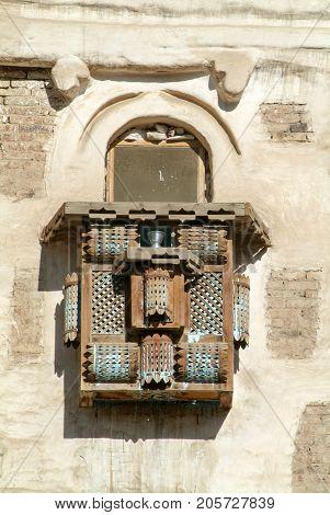 Sana,Yemen - 5 January 2007: Wooden lattice of a balcony enclosure on a traditional Arabian building of old Sana on Yemen