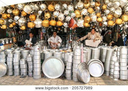 People Selling Teapots And Plates On The Market Of Sana