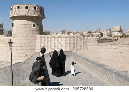 People Walking On The Bridge Near Old Sana