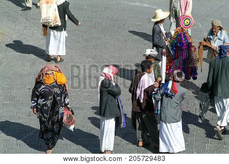 People In Conversation On The Main Square Of Old Sana