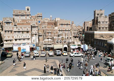 People Walking On The Main Square Of Old Sana