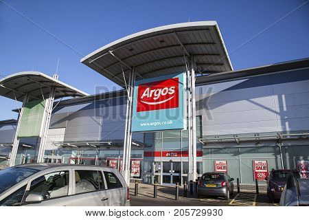 Swansea, UK: December 28, 2016: Main entrance to an Argos Megastore taken from the car park with disabled parking available near the store.