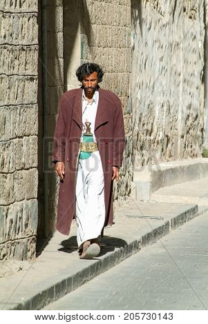 Man With Traditional Clothes Walking On The Street Of Sana