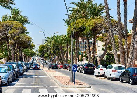 Orihuela Spain - August 17; 2017: Street of Orihuela city La Zenia district with parked cars. Costa Blanca. Spain
