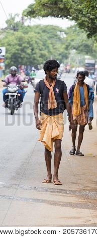 PONDICHERY PUDUCHERY INDIA - AUGUST 28 2017. Unidentified christians catholics hinduists people with orange dress pilgrims walk from chennai to Velanganni for annual pilgrimage at the church of Velankanni. They walk more than 250 kilometers.