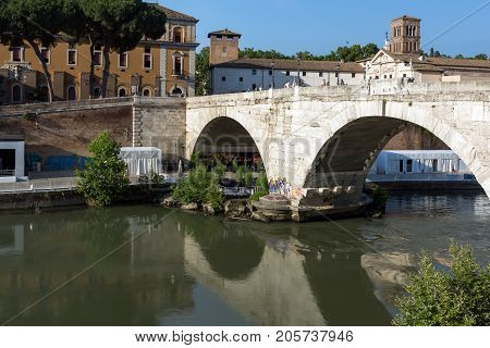 ROME, ITALY - JUNE 22, 2017: Amazing view of Tiber River and Pons Cestius in city of Rome, Italy