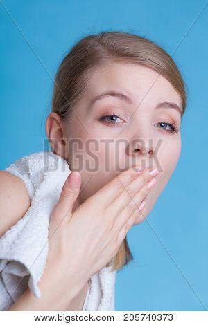 Bored Sleepy Woman Yawning While Holding Towel