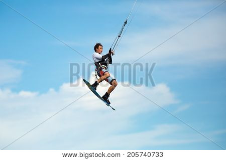 January 25 2014 Los Barriles Mexico: kiteboarder lifts off from water and leaps in air at the 'Lord of the Wind' kite surf competition