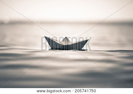 Paper boat on sea waves. toned image of paper boat. Paper boat in ocean