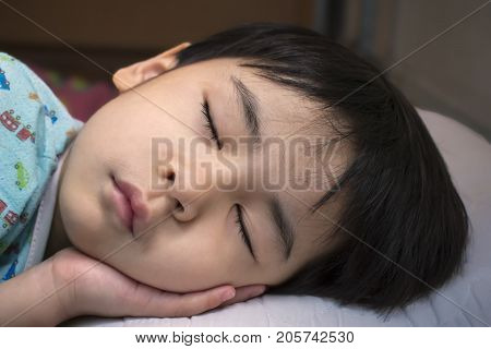 A Toddler Boy Snoozing in the Afternoon