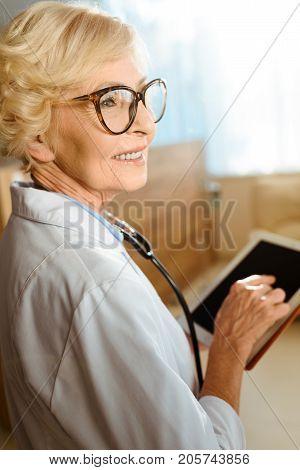 Senior Doctor With Digital Tablet