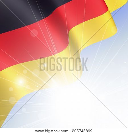 National flag of Germany waving in the wind in the rays of the sun. German State Symbol closeup