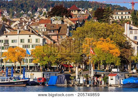 Zurich, Switzerland - 25 September, 2017: embankment of the Limmat river in the city of Zurich in the evening, old town buildings in the background. Zurich is the largest city in Switzerland and the capital of the Swiss canton of Zurich.