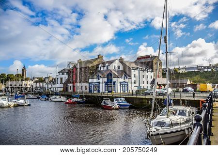 DOUGLAS, ISLE OF MAN - OCTOBER 17: Yacht docking at bay in a nice small port in a clear blue sky day in a small town of Douglas, Isle of Man