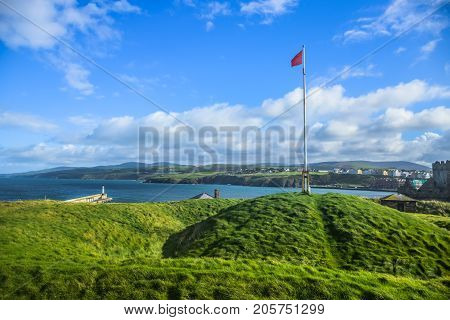 Isle of Man national flag on top of Peel hill inside Peel Castle in Peel city, Isle of Man