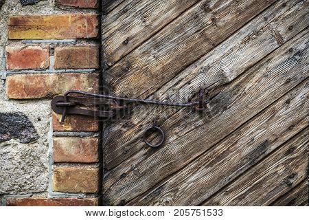 the old wooden door with rusty strength