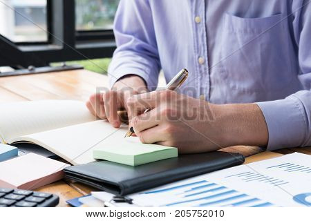 Businessman Write Note On Notebook At Office Desk. Man Write Memo With Fountain Pen At Workplace.