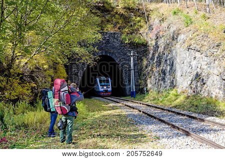 Autumn Circum-Baikal Railway l with backpackers on south lake Baikal. Russia
