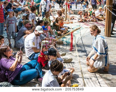 Jerusalem Israel September 23 2017 : Knight girl communicates with visitors at the festival
