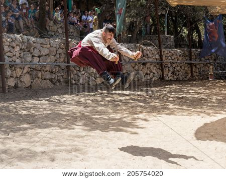 Jerusalem Israel September 23 2017 : The Ukrainian Cossack demonstrates the possession of two sickles at the festival