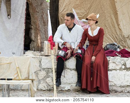 Jerusalem Israel September 23 2017 :A knight with a beautiful lady rests between fights at the festival