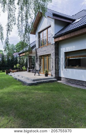 House With Brick Walls And Garden